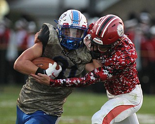 Adam Gatrell (31) of Western Reserve tries to fight off a tackle by Columbiana's Xathon Cross (6) during Thursday night's matchup at Firestone Park in Columbiana. Dustin Livesay  |  The Vindicator  8/23/18  Columbiana