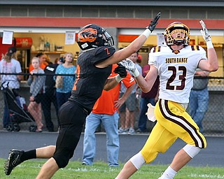 NEW MIDDLETOWN SPRINGFIELD, OHIO -August 24, 2018: SOUTH RANGE RAIDERS vs SPRINGFIIELD TIGERS at Tigers Stadium-  South Range Raiders' Chris Brooks (23) makes a one handed TD catch against Middletown Springfield Tigers' Evan Ohlin (2) during the 2nd. qtr.  MICHAEL G. TAYLOR | THE VINDICATOR..