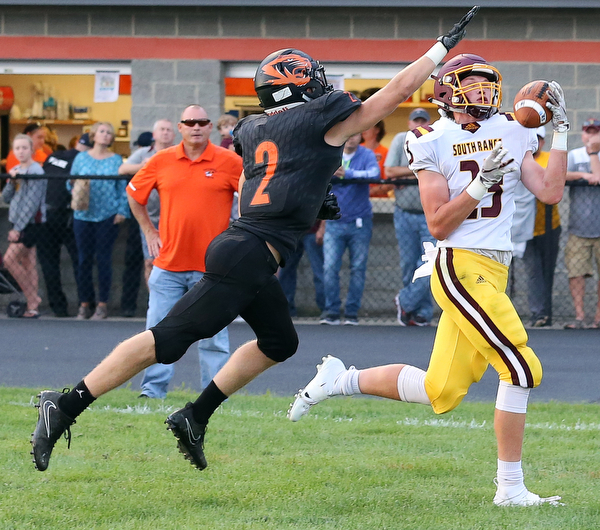 NEW MIDDLETOWN SPRINGFIELD, OHIO -August 24, 2018: SOUTH RANGE RAIDERS vs SPRINGFIIELD TIGERS at Tigers Stadium-  South Range Raiders' Chris Brooks (23) makes a one handed TD catch against Middletown Springfield Tigers' Evan Ohlin (2) during the 2nd. qtr.  MICHAEL G. TAYLOR | THE VINDICATOR