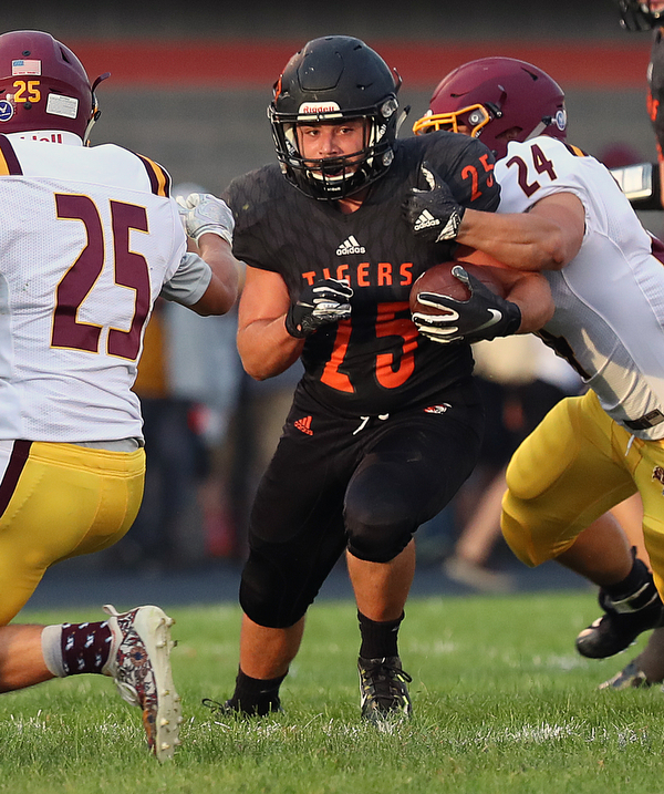 NEW MIDDLETOWN SPRINGFIELD, OHIO -August 24, 2018: SOUTH RANGE RAIDERS vs SPRINGFIIELD TIGERS at Tigers Stadium-   Middletown Springfield Tigers' Luke Snyder (25) breaks the attempted tackle of South Range Raiders' Anthony DeLucia (24) during the1st qtr.  MICHAEL G. TAYLOR | THE VINDICATOR