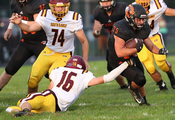 NEW MIDDLETOWN SPRINGFIELD, OHIO -August 24, 2018: SOUTH RANGE RAIDERS vs SPRINGFIIELD TIGERS at Tigers Stadium-   Middletown Springfield Tigers' Eric Dunkel (15) runs by South Range Raiders'Alec Ballentine (16) during the 1st qtr.  MICHAEL G. TAYLOR | THE VINDICATOR..