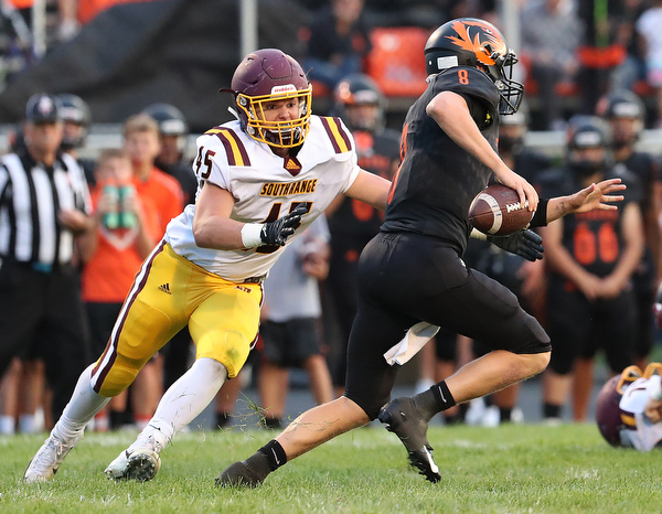 NEW MIDDLETOWN SPRINGFIELD, OHIO -August 24, 2018: SOUTH RANGE RAIDERS vs SPRINGFIIELD TIGERS at Tigers Stadium-  South Range Raiders' Ryan Davenport (45) zeros in on  Middletown Springfield Tigers' Brannon Brungard (8) during the 2nd. qtr.  MICHAEL G. TAYLOR | THE VINDICATOR