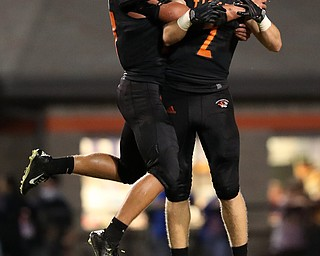 NEW MIDDLETOWN SPRINGFIELD, OHIO -August 24, 2018: SOUTH RANGE RAIDERS vs SPRINGFIIELD TIGERS at Tigers Stadium-  Springfield Tigers' Zachary Stouffer and Mitchell Seymour celebrate their victory.  MICHAEL G. TAYLOR | THE VINDICATOR