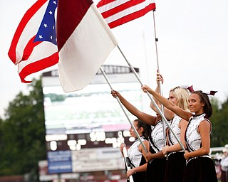 Boardman's flagline holds flags while Boardman's alma mater plays before the game against East at Boardman on Friday night. EMILY MATTHEWS | THE VINDICATOR