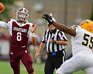 BOARDMAN, OHIO - AUGUST 24, 2018: Boardman quarterback Mike O'Horo throws a pass while being pressured by East's Christopher Fitzgerald during the fist half of their game on Friday night at Boardman high school. DAVID DERMER | THE VINDICATOR