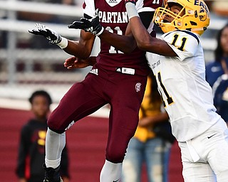 BOARDMAN, OHIO - AUGUST 24, 2018: Boardman receiver Che Trevena catches a pass while being defended by East defensive backMarshall Herron during the fist half of their game on Friday night at Boardman high school. DAVID DERMER | THE VINDICATOR