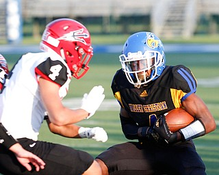 Valley Christian's Tyrone Lindsey tries to get past Campbell's Nikita Klimis during the first half of their game Saturday night at Dave Pavlansky Field in Poland. EMILY MATTHEWS | THE VINDICATOR