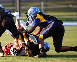 Campbell's Daquan Bebbs is tackled by Valley Christian during the first half of their game Saturday night at Dave Pavlansky Field in Poland. EMILY MATTHEWS | THE VINDICATOR