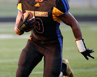 Valley Christian's Altwjuan Beck-Lindsey runs the ball during the first half of the game against Campbell Saturday night at Dave Pavlansky Field in Poland. EMILY MATTHEWS | THE VINDICATOR