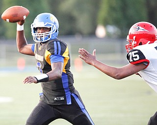 Valley Christian's Milan Square prepares to throw the ball as Campbell's Jashon Flores advances toward him during the first half of their game Saturday night at Dave Pavlansky Field in Poland. EMILY MATTHEWS | THE VINDICATOR