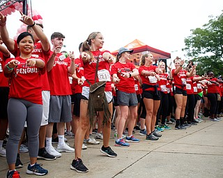 Students on the YSU nurses race team conduct a flash mob before the start of Panerathon outside of Covelli Centre on Sunday. .EMILY MATTHEWS | THE VINDICATOR