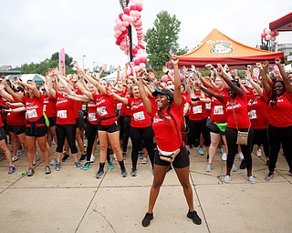 Shauntiaonia Johnson, center, a senior studying nursing at YSU, conducts a flash mob with other nursing students before the start of Panerathon outside of Covelli Centre on Sunday. .EMILY MATTHEWS | THE VINDICATOR