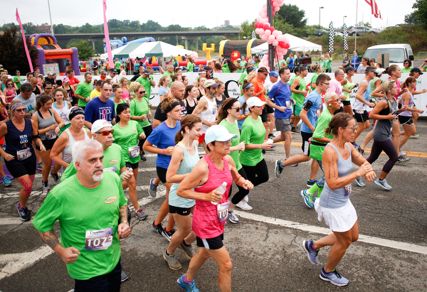 Runners participating in the 10k race take off at Panerathon outside of Covelli Centre on Sunday. .EMILY MATTHEWS | THE VINDICATOR