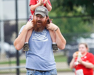 Danny Young, of Kinsman, and his son Orry Young cheer on 10k runners on Walnut Street during Panerathon on Sunday. .EMILY MATTHEWS | THE VINDICATOR
