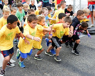 Boys ages seven and under take off for the quarter-mile-long Kids Run at Panerathon outside of Covelli Centre on Sunday. .EMILY MATTHEWS | THE VINDICATOR
