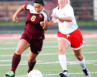South Range's Marie DePascale and Niles McKinley's Ella Perrone fight over the ball during the game Monday night at South Range.