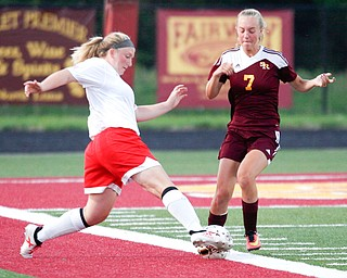 Niles McKinley's Mackenzie Johnston kicks the ball past South Range's Addie Flowers during their game Monday night at South Range.