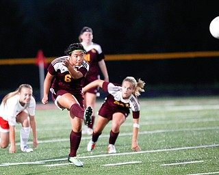 South Range's Marie DePascale kicks the ball downfield during the game against Niles McKinley Monday night at South Range.