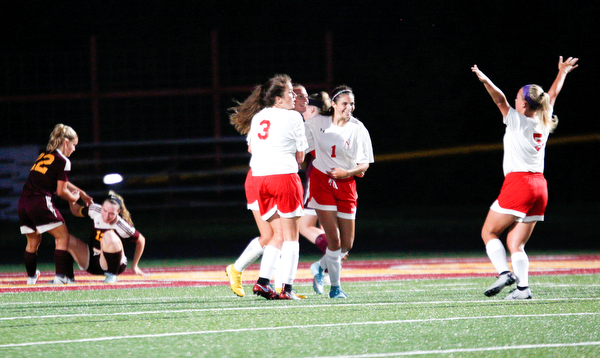 Niles McKinley celebrates after Jaycee Ward scores in the second half to get them in the lead 4-3 against South Range Monday night at South Range.
