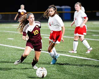 South Range's Anna Finocchi tries to kept the ball away from Niles McKinley during their game Monday night at South Range.