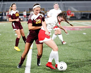 Niles McKinley's Isabella Sergi tries to keep the ball away from South Range's Kiley McConnell during their game Monday night at South Range.