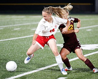 Niles McKinley's Allison Cline tries to keep the ball away from South Range's Alyssa Tracy during their game Monday night at South Range.