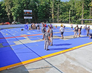 ROBERT K.YOSAY  | THE VINDICATOR..Mill Creek ParkÕs old ice skating rink is getting a blue makeover courtesy of a team that wears black and gold..On Tuesday morning, volunteers from Mill Creek MetroParks, Home Savings and Loan, the Youngstown Phantoms and The Pittsburgh Penguins Foundation were laying down blue tiles for the ParkÕs new dek hockey rinkNiles McKinley's Isabella Sergi tries to keep the ball away from South Range's Kiley McConnell during their game Monday night at South Range.
