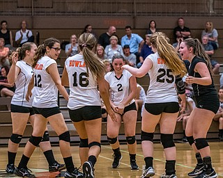 DIANNA OATRIDGE | THE VINDICATOR The Howland volleyball team celebrates after scoring a point during their match against Boardman in Howland on Tuesday. The Spartans won the match 3-0.