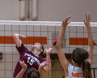 DIANNA OATRIDGE | THE VINDICATOR Boardman's Kaylin Burkey (15) attempts a kill as Howland's Mia Pantalone (left) and Maddie Sisler (right) prepare to block during their match in Howland on Tuesday. The Spartans won 3-0.