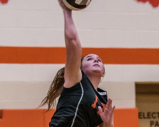 DIANNA OATRIDGE | THE VINDICATOR Howland's Haley Vandergrift jump serves during their match versus Boardman on Tuesday. The Spartans won 3-0.