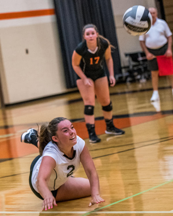 DIANNA OATRIDGE | THE VINDICATOR Howland's Bailee Beasom (2) digs the ball as her teammate Haley Vandergrift (17) looks on during their match versus Boardman on Tuesday. The Spartans won 3-0.
