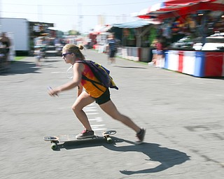 ROBERT K.YOSAY  | THE VINDICATOR..the 172  Canfield Fair is underway at the fairgrounds in Canfield- 52 rides and hundreds of vendors are ready for the traditional end of summer festivities..Skateboarder found a quicker way to get around the fairgrounds