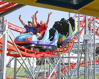 ROBERT K.YOSAY  | THE VINDICATOR..the 172  Canfield Fair is underway at the fairgrounds in Canfield- 52 rides and hundreds of vendors are ready for the traditional end of summer festivities..the inaugural ride as President David Dickey and Tony Parks race down a hill on THE AVENGER