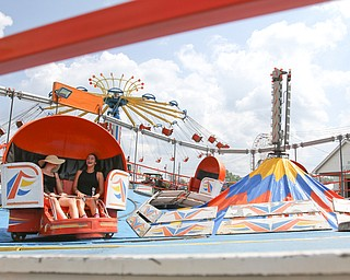 ROBERT K.YOSAY  | THE VINDICATOR..the 172  Canfield Fair is underway at the fairgrounds in Canfield- 52 rides and hundreds of vendors are ready for the traditional end of summer festivities..rides rides rides   tilt a whirl and chain swing in background one of 52 rides.