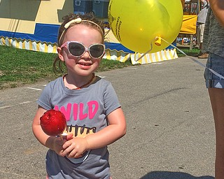 ROBERT K.YOSAY  | THE VINDICATOR..the 172  Canfield Fair is underway at the fairgrounds in Canfield- 52 rides and hundreds of vendors are ready for the traditional end of summer festivities..Yep 2.5 year old Madison Greenawalt of Canfield with candy apple in hand was ready for fair food and fun with her mom renea