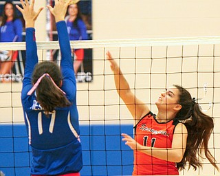 William D. Lewis The Vindicator Western Reserve's Taylor Mayorga(17) tries to block a shot from Springfield'sZoeRenaldy(11) during 8-30-18 asction at Western Reserve.