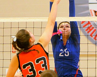 William D. Lewis The Vindicator Western Reserve's Danielle Vuletich(25) shoots past Springfield's Lyndsey Smith(33) duringh 8-30-18 asction at Western Reserve.