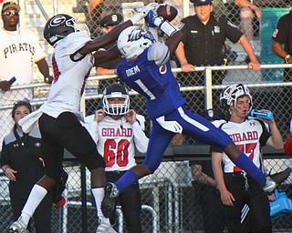 William D. Lewis The Vindicator  Hubbard's JayQuan Odem(1) intercepts a pass intended for Girard's Terrance Davis(14) during the Aug. 31 game at Hubbard.