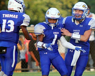 William D. Lewis The Vindicator  Hubbard's JayQuan Odem(1) gets congratulated by Dean Thomas (13) and Cam Resatar (7) after intercepting a first quarter pass during the Aug. 31 game at Hubbard.