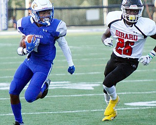 William D. Lewis The Vindicator  Hubbard's JayQuan Odem(1) eludes Girard's Robert Dolwick (26) during the Aug. 31 game at Hubbard.
