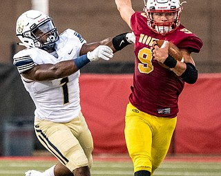 DIANNA OATRIDGE | THE VINDICATORÊ Cardinal Mooney's Jason Santisi gets pushed out of bounds by Akron Hoban's Deamonte Trayanum during their game at Stambaugh Stadium in Youngstown on Friday night.