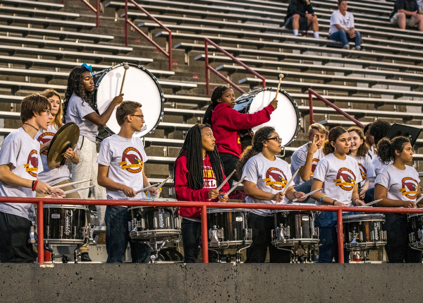 DIANNA OATRIDGE | THE VINDICATORÊ The drumline from the Cardinal Mooney band plays a cadence during the Cardinals' game versus Akron Hoban at Stambaugh Stadium in Youngstown on Friday night..