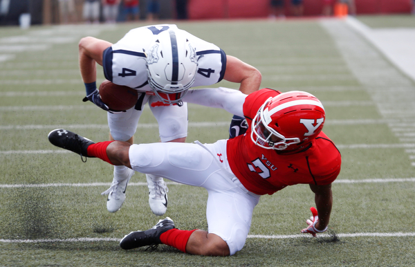 YSU's Bryce Gibson tackles Butler's Pace Temple during the first half of the game on Saturday.