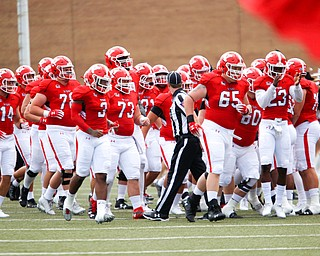 The YSU football team runs onto the field for their first game of the season against Butler on Saturday.