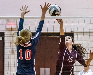 DIANNA OATRIDGE | THE VINDICATOR Boardman's Kaylin Burkey, tips the ball as Austintown Fitch's Emma Bartlett attempts to block during their AAC match in Boardman on Tuesday. The Spartans rallied to win 3-2.