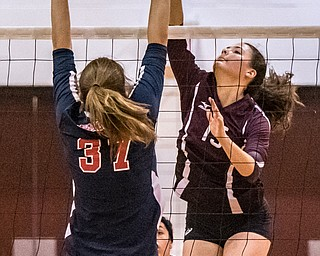 DIANNA OATRIDGE | THE VINDICATOR Boardman's Kaylin Burkey, attempts a kill as Austintown Fitch's Cate Maguire goes up for the block during their AAC match in Boardman on Tuesday. The Spartans rallied to win 3-2.