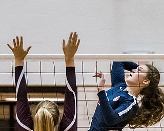 DIANNA OATRIDGE | THE VINDICATORÊ Austintown Fitch's Chelsie Wheeler goes up for a kill against the defense of Boardman's Madi Ricciuti during their AAC match in Boardman on Tuesday. Boardman rallied to win 3-2.