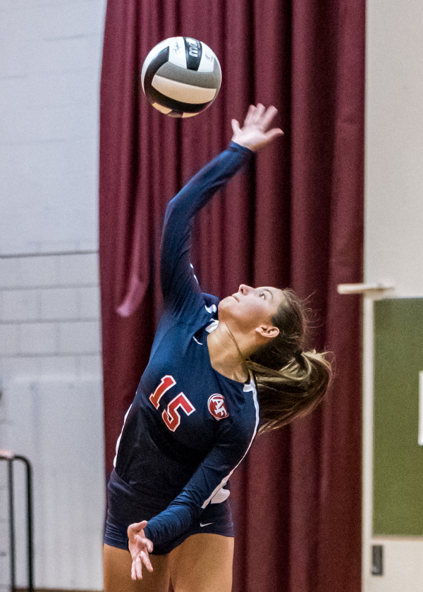 DIANNA OATRIDGE | THE VINDICATOR Austintown Fitch's Alyssa Leskovac jump serves during their AAC match versus Boardman on Tuesday. The Spartans rallied to win 3-2..