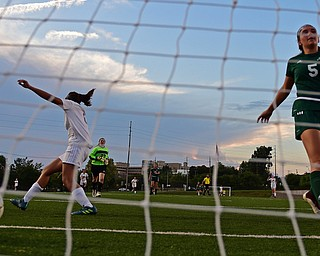 YOUNGSTOWN, OHIO - SEPTEMBER 5, 2018: Boardman's Serene Khatib, left, celebrates after scoring a goal while Ursuline's Kenzie Larch shows her frustration during the second half of their game on Wednesday night at the Youngstown State soccer complex. DAVID DERMER | THE VINDICATOR