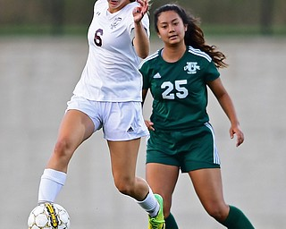 YOUNGSTOWN, OHIO - SEPTEMBER 5, 2018: Boardman's Anna Deeley kicks the ball away from Ursuline's Sering Limbu during the second half of their game on Wednesday night at the Youngstown State soccer complex. DAVID DERMER | THE VINDICATOR
